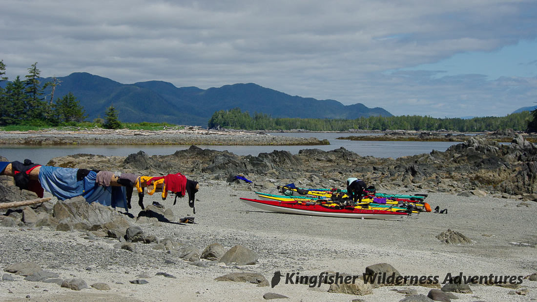 Great Bear Rainforest Kayak Expedition - Hanging gear on a log to dry in the sun.