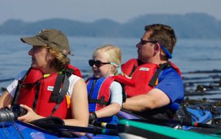 Family Kayak With Whales