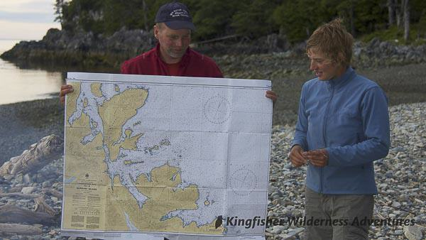 Northern Gwaii Haanas Kayak Tour - Reviewing our kayaking route on the chart.