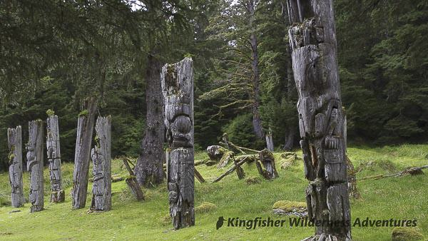 Southern Gwaii Haanas Kayak Tour - The memorial and mortuary poles at the UNESCO World Heritage Site of Ninstints (SGang Gwaay Linagaay)
