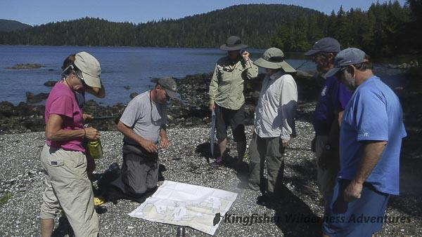 Southern Gwaii Haanas Kayak Tour - Reviewing our kayaking route on the chart.